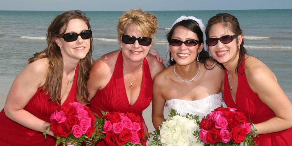 Bride with Bridesmaids on Beach